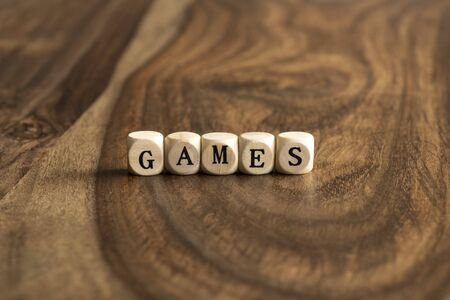 word game: Word game made with wooden block letters over the wooden board surface