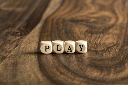 wood blocks: PLAY word background on wood blocks Stock Photo
