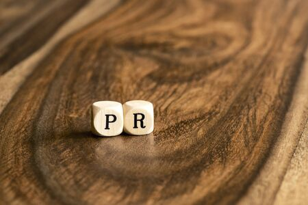 pr: PR word background on wood blocks