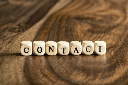 contact us icon: CONTACT word background on wood blocks Stock Photo
