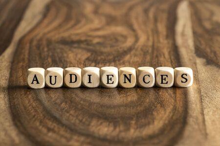 audiences: AUDIENCES word background on wood blocks