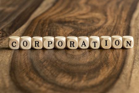 Corporations: CORPORATION word background on wood blocks Stock Photo