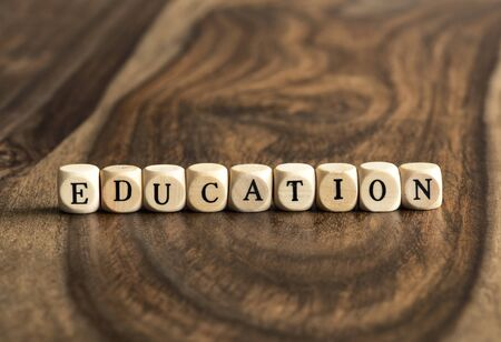 wood blocks: EDUCATION word background on wood blocks Stock Photo