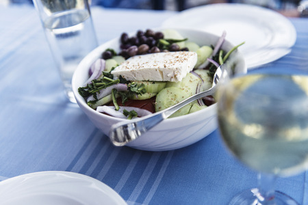 Healthy greek salat on the plate with vegetables and feta cheese, Greece