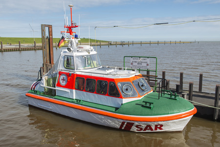 Horumersiel, Germany - March 11, 2017: Search and Rescue, SAR, boat of Germany life saving association, port of Horumersiel, North Sea, Germany. The DGzRS is responsible for Search and Rescue in German territorial waters.