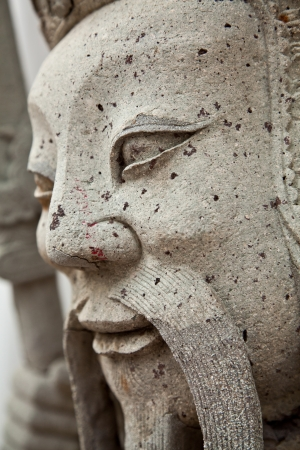 Face of the ancient Chinese warrior statues ,Wat Pho photo