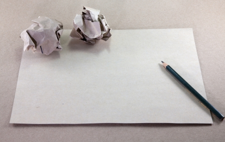 Writing concept - crumpled up paper wads with paper  photo