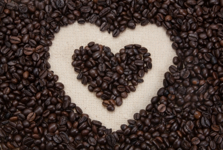 Heart shape made from coffee beans photo