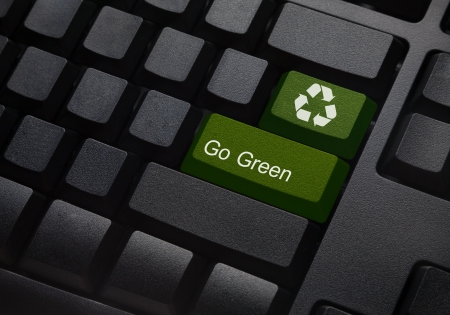 Go green key with wind turbine icon on keyboard photo