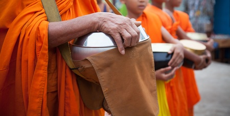 Offer food to monk on early morning photo