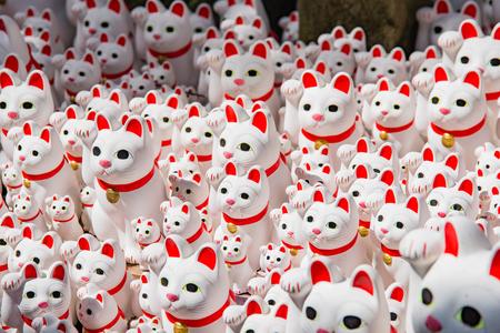 neko: Maneki neko also known as chinese fortune cat Stock Photo