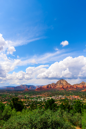 chaparral: Amazing Red Rock Country near Sedona, Arizona. Displaying colorful sand and limestone rocks and cliffs, with blue sky and white clouds.