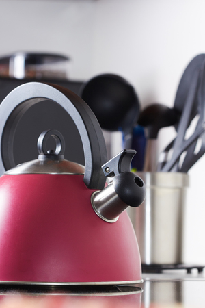 red tea on a background of kitchen utensils, teapot Stock Photo
