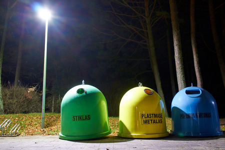 segregate: Garbage cans in a dark alley under a streetlight