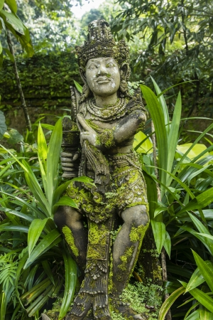An ancient balinese statue in the temple Stock Photo