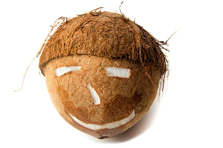 Face shaped cut coconut on a white background Stock Photo