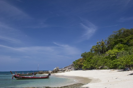 Nice beach with a boat near it  Made in Thailand  Stock Photo - 17069637