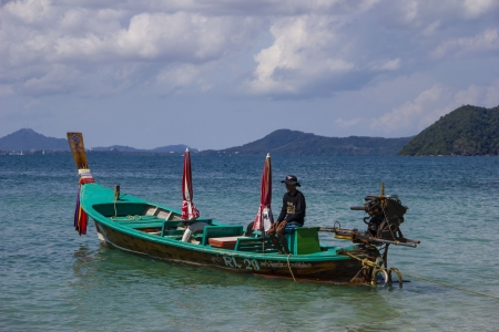 Traditional thai fishing boat near Phuket island, Thailand  Stock Photo - 17069634