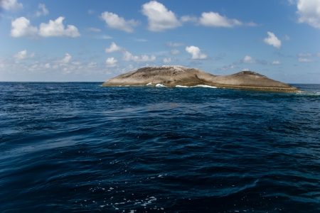 Lonely rock island in the middle of the sea  Stock Photo - 17169054