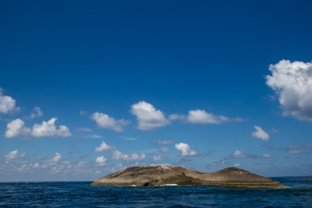 Lonely rock island in the middle of the sea. Stock Photo - 17308429