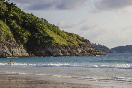 A beach landscape with a surefr on the backview. Thailand Stock Photo - 17853574