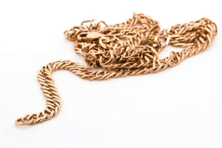 A gold chain isolated on a white background.