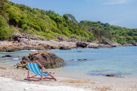 An empty beach with a chair and nobody around. Stock Photo - 17853555