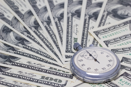 100-dollar bills with a timer on it  Full frame