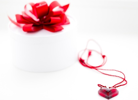Gift box and heart shaped coulon - romantic present Stock Photo