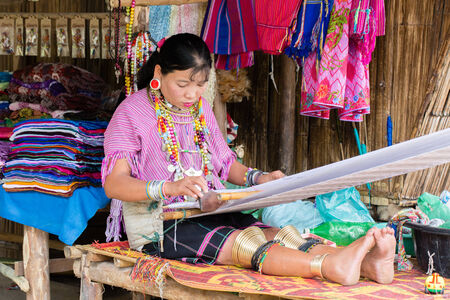 A woman from Karen tribes working Editorial