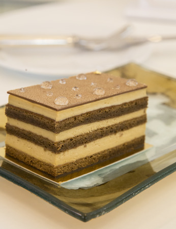 footplate: Tiramisu cake served in the restaurant on golden plate