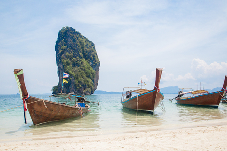 Three traditional thai longtail boats on the beach Stock Photo