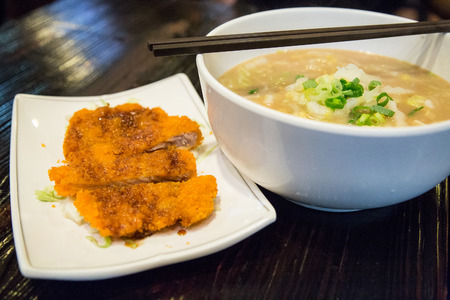 Chinese food - noodle soup with fried chicken