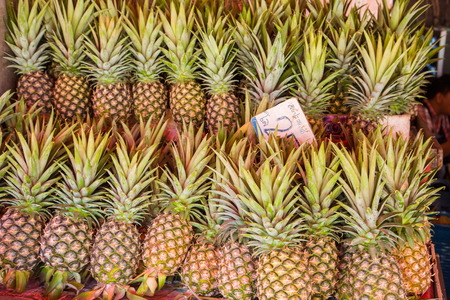 Pineapples for sale on the market in Thailand Stock Photo