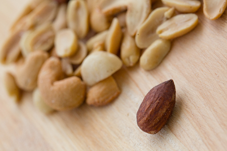 Almond with the other nuts on the background Banco de Imagens
