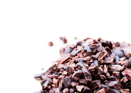 fermented and processed cacao nibs on the light background
