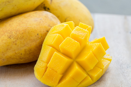 Sweet Thai yellow mangoes with a cut half Stock Photo