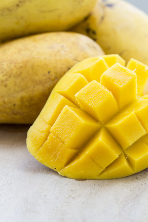 Yellow Thai mangos with a slice cut in squares Stock Photo