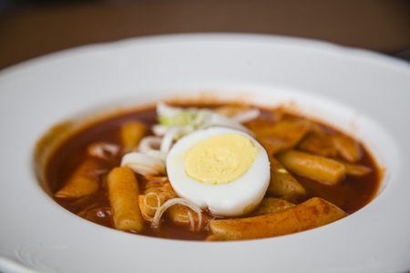Korean food tteokbokki served with Korean sushi rolls