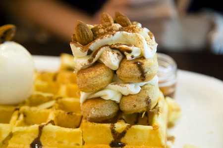 Tiramisu style waffles served on the plate with almonds and cinnamon Banco de Imagens