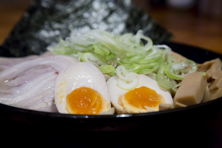 Ramen Set with eggs, pork, seaweed and spring onions Banco de Imagens