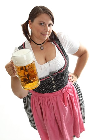 german alcohol: Bavarian Waitress with Octoberfest Beer looking up to viewer. dressed with a traditional dirndl