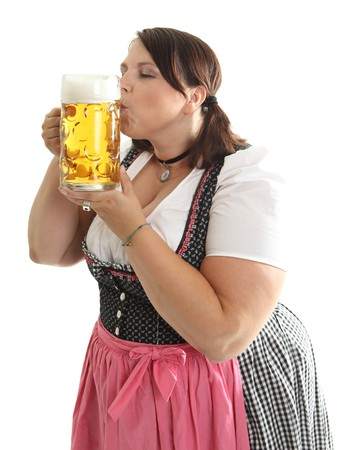 A bavarian girl kissing Oktoberfest beer mug, dressed in a traditional dirndl