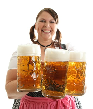 Bavarian Waitress with Oktoberfest Beer in front Stock Photo