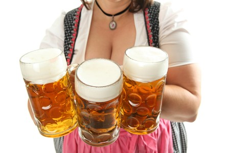 Bavarian Waitress with Oktoberfest Beer in front of her cleavage