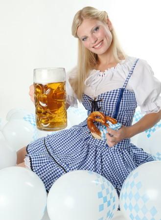 dirndl: Bavarian Oktoberfest Girl cheers with Beer Mug Stock Photo