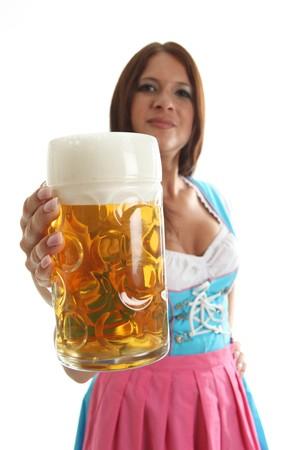 dirndl dress: Bavarian waitress holding a Oktoberfest Beer Mug, waitress in the background