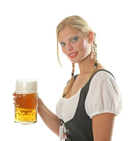 Bavarian Girl cheers with a beer and is dressed with a traditional german dirndl photo
