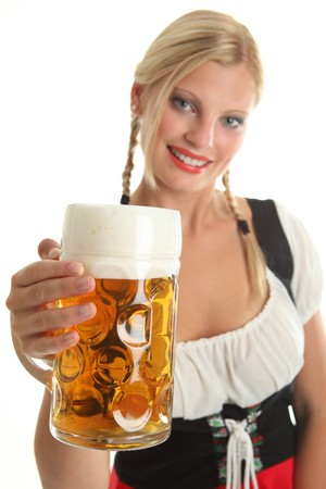 Bavarian Girl cheering with Oktoberfest Beer, girl in the background Stock Photo