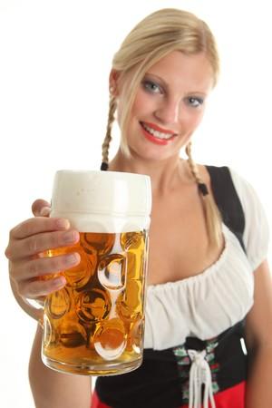 Bavarian Girl cheering with Oktoberfest Beer, girl in the background Standard-Bild
